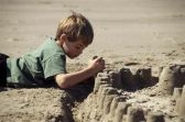 Boy_building_sandcastle