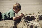 Boy_building_sandcastle