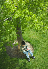 Contentment.reading_book_under_tree