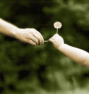 Giving.mother.child.flower