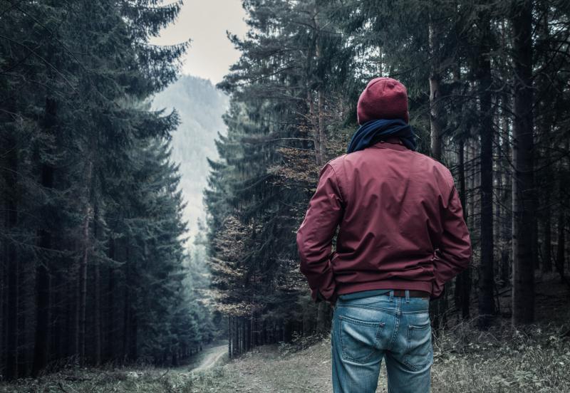 Bigstock-Sad-man-walking-by-forest-77739890